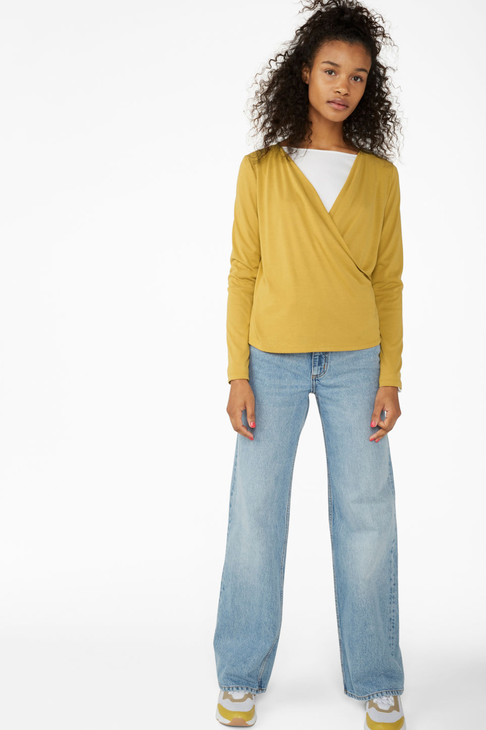 Model side image of Monki super-soft wrap top in yellow