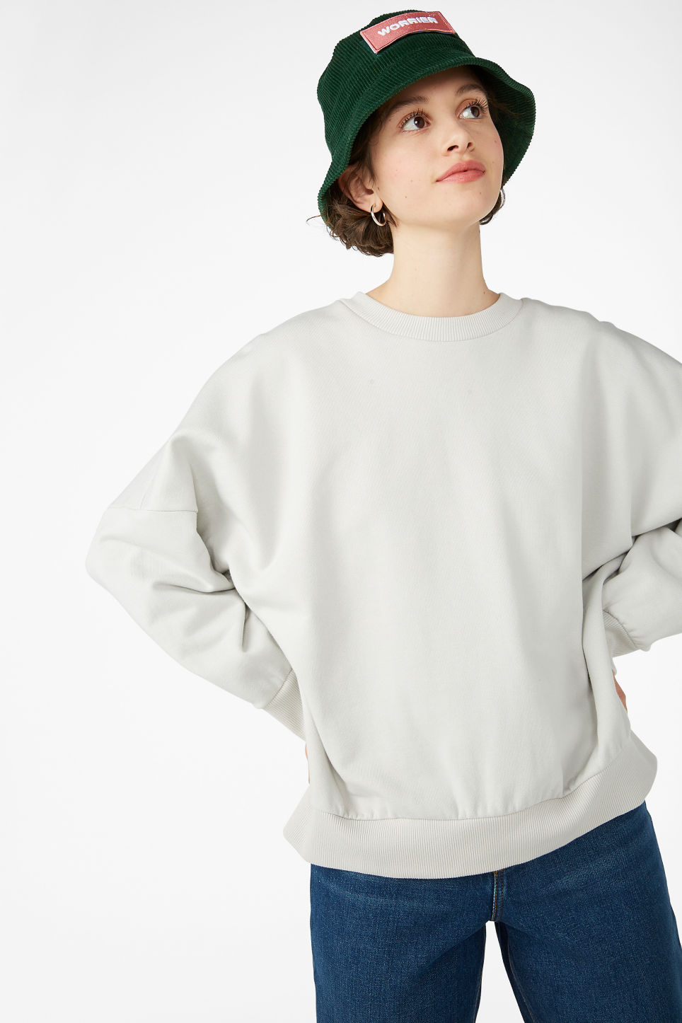 Model front image of Monki cotton sweatshirt in beige