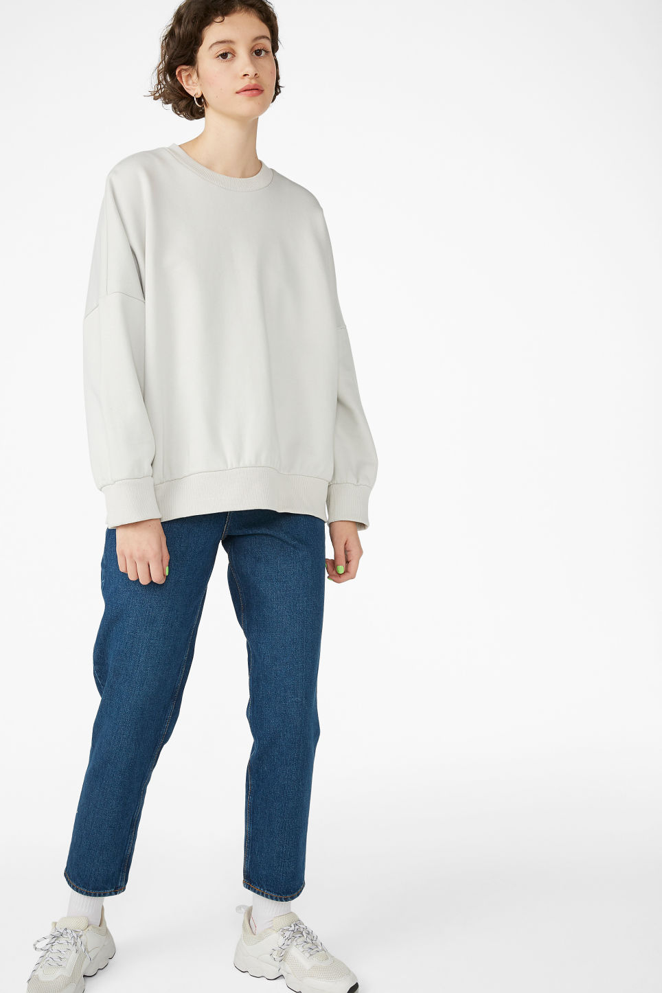 Model side image of Monki cotton sweatshirt in beige