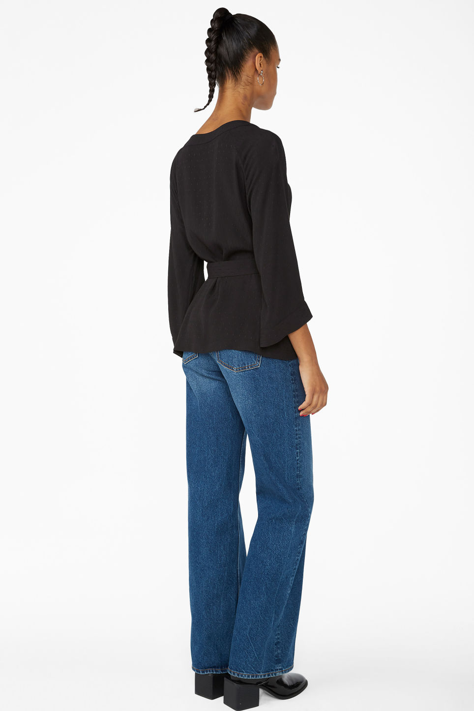 Model back image of Monki belted boat neck blouse in black