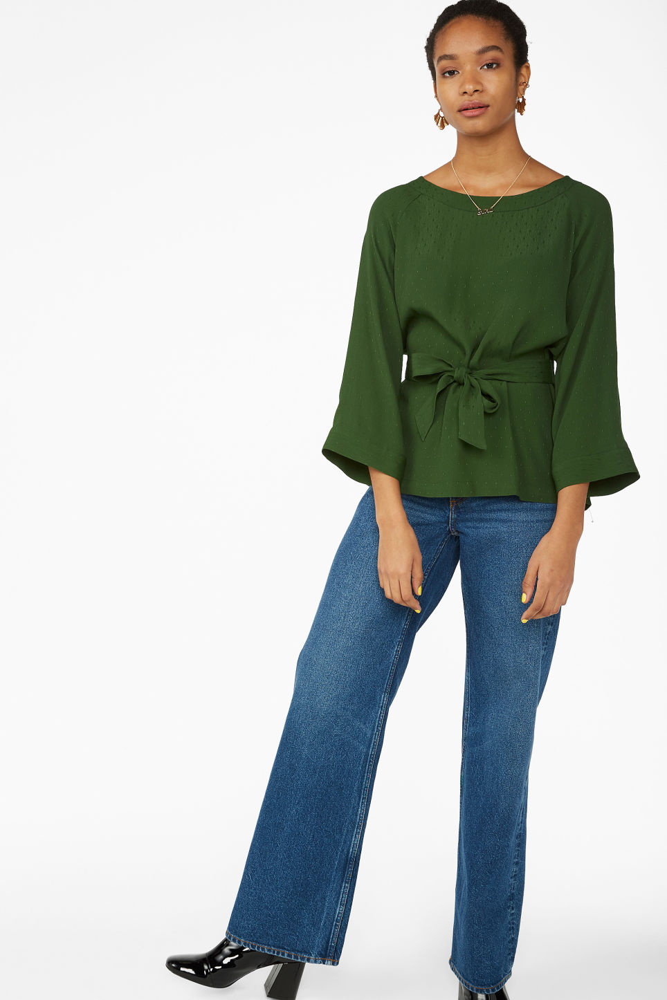 Model side image of Monki belted boat neck blouse in green