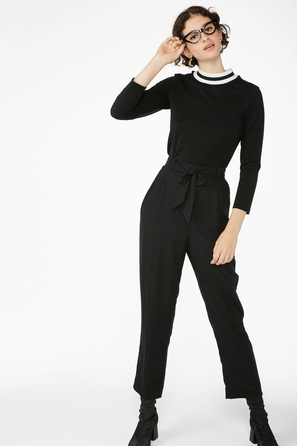 Model side image of Monki glittery top in black