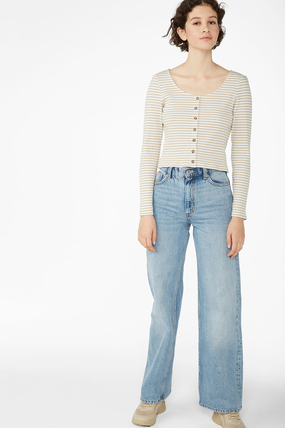 Model side image of Monki buttoned long-sleeved top in beige