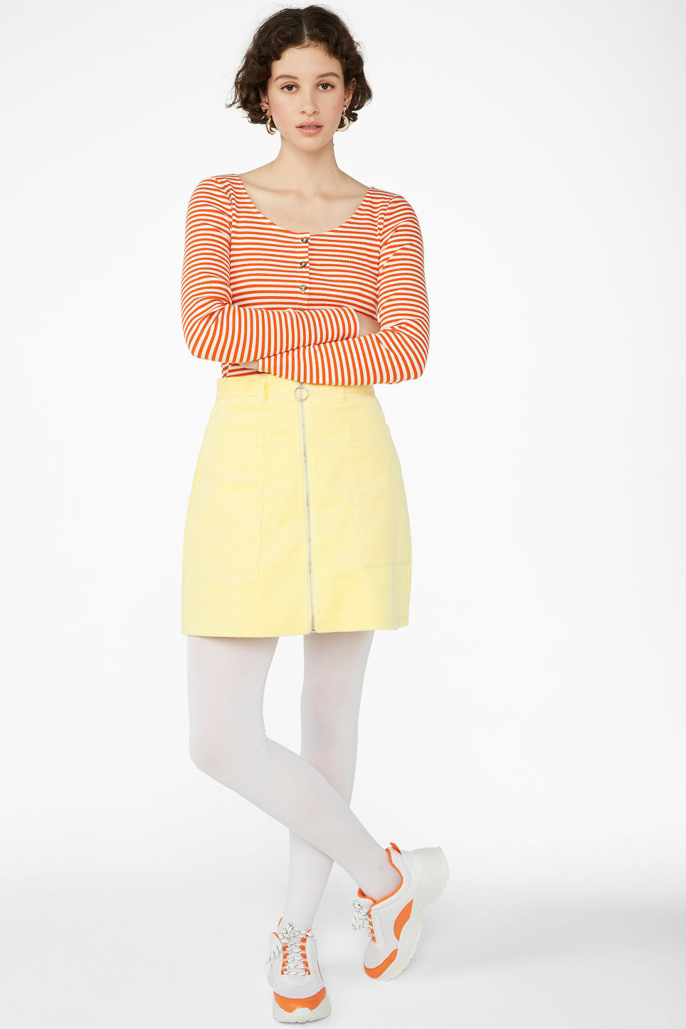 Model side image of Monki buttoned long-sleeved top in orange