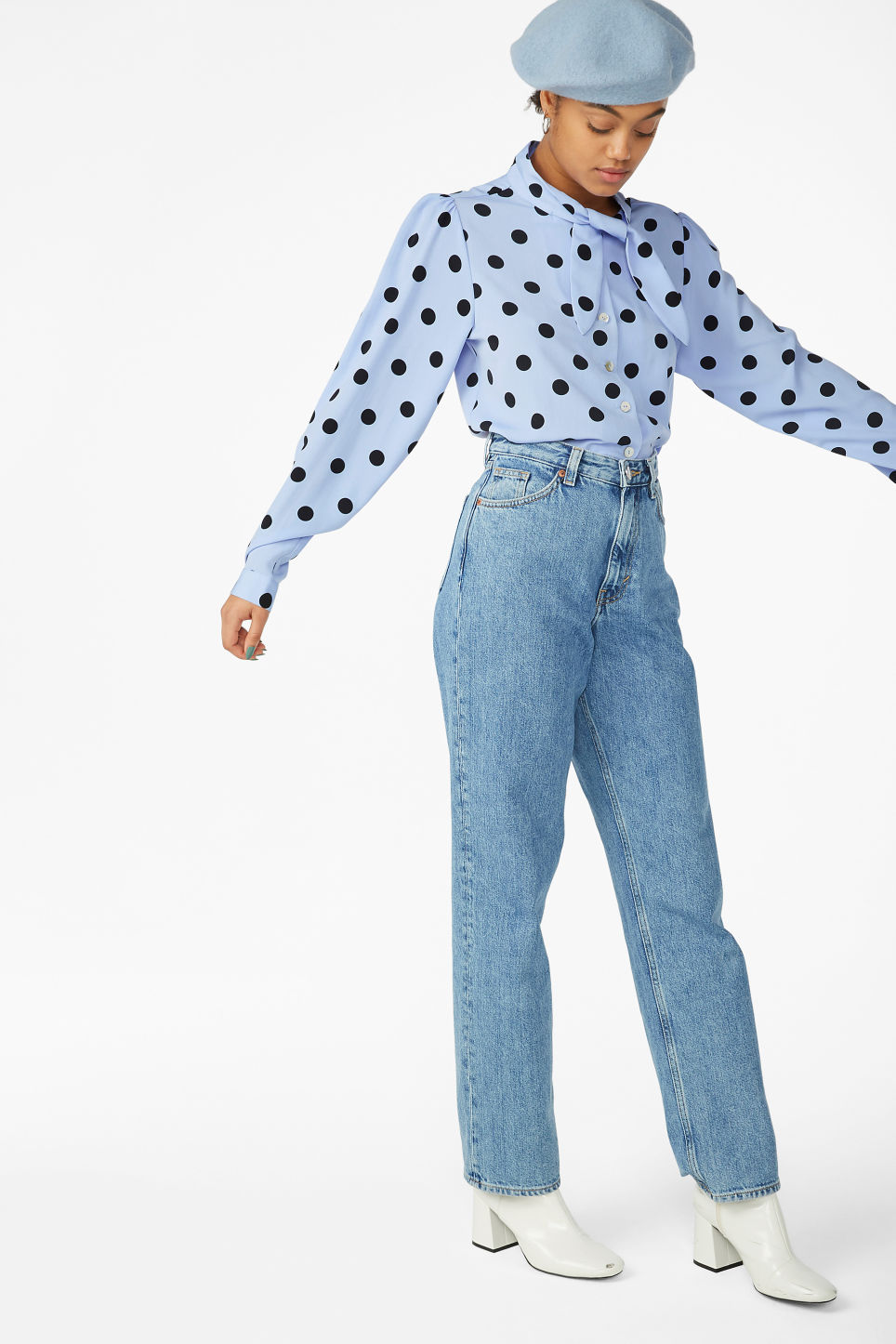 Model side image of Monki tie neck blouse in blue