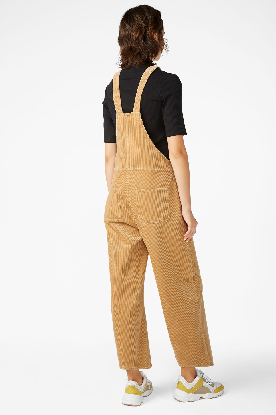 Model back image of Monki corduroy dungarees in beige
