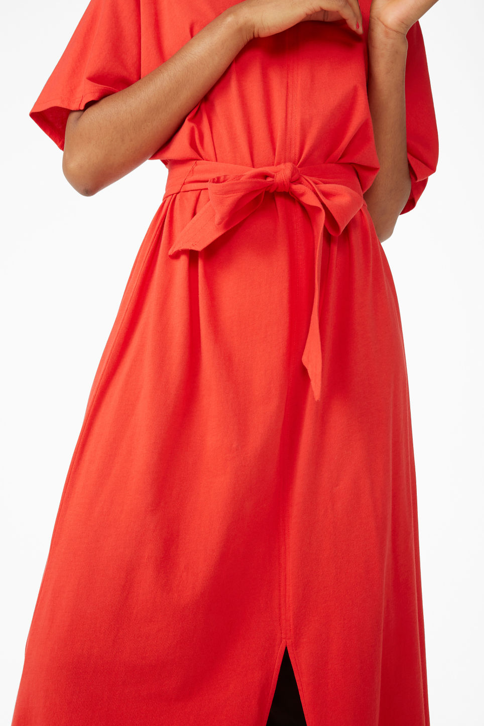 Model side image of Monki belted t-shirt dress in red