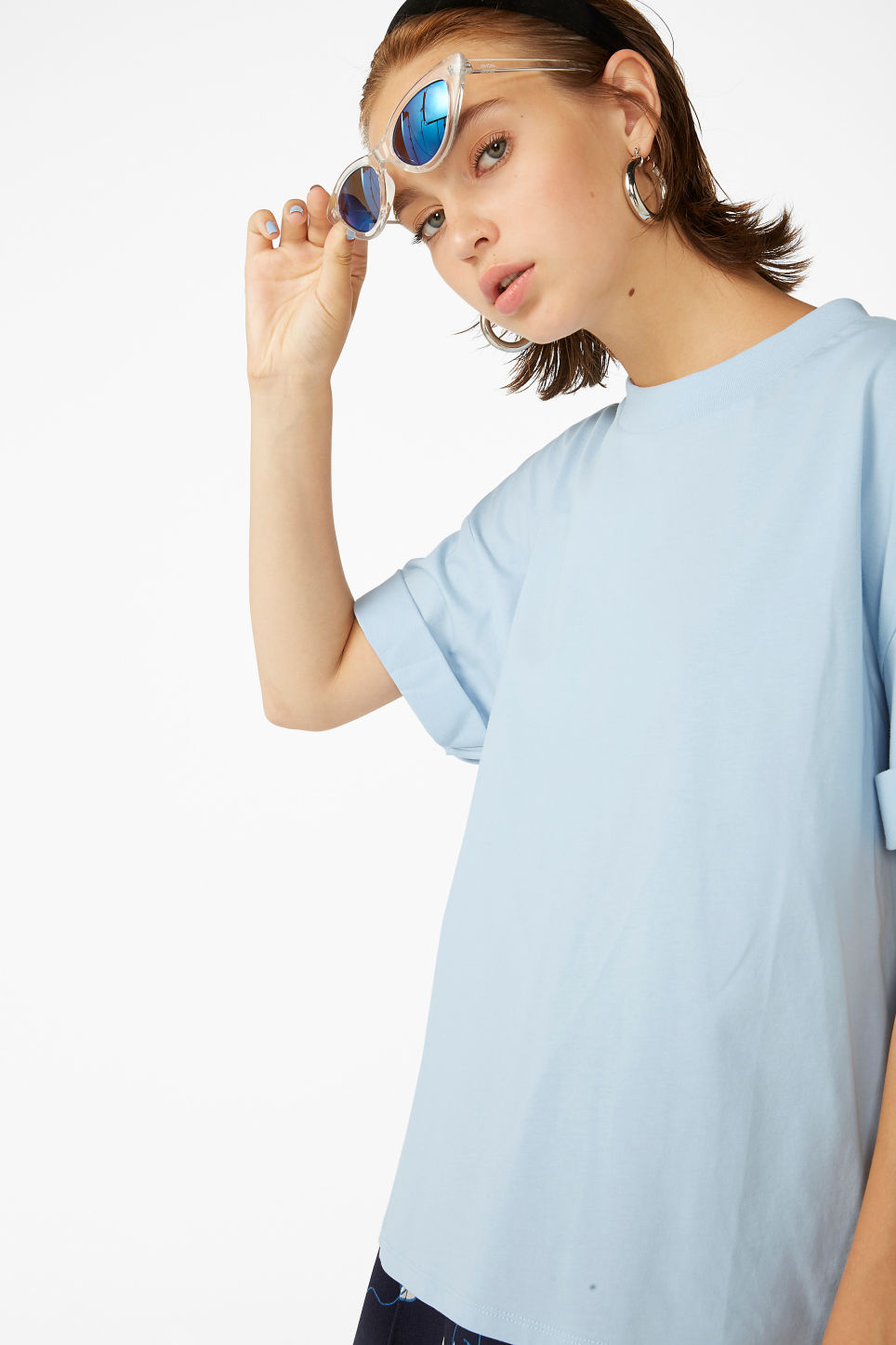 Model front image of Monki rolled sleeve t-shirt in blue
