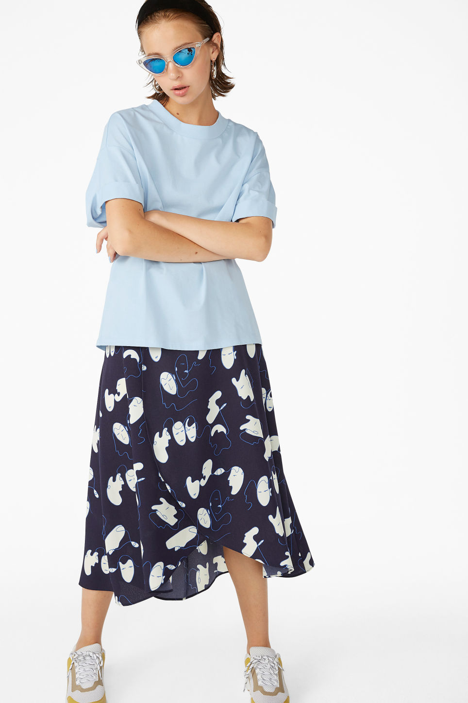 Model side image of Monki rolled sleeve t-shirt in blue