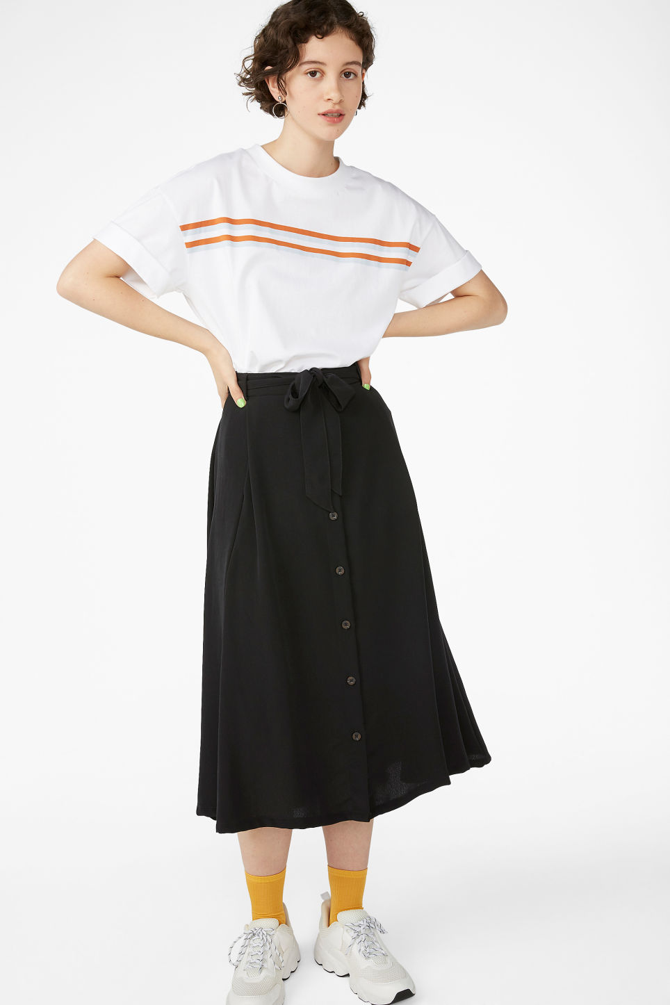 Model side image of Monki rolled sleeve t-shirt in white