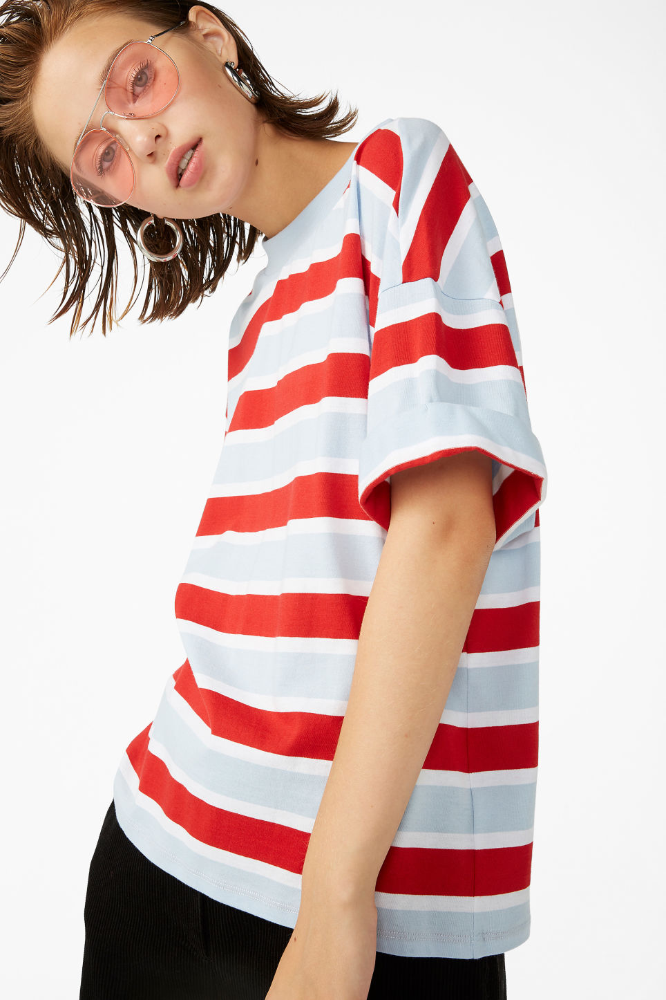 Model front image of Monki rolled sleeve t-shirt in red