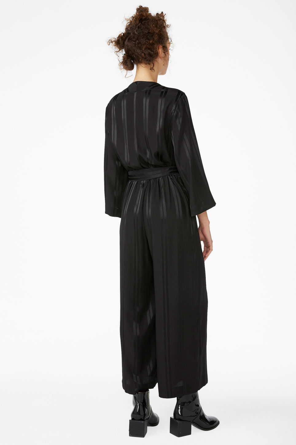 Model back image of Monki dressy jumpsuit in black