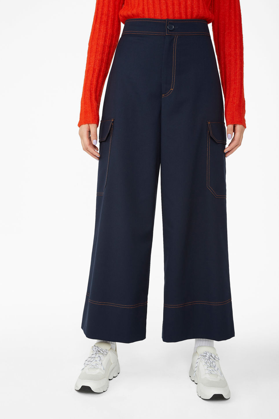 Model side image of Monki utilitarian trousers in blue