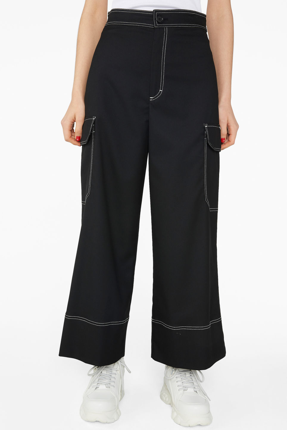 Model side image of Monki utilitarian trousers in black