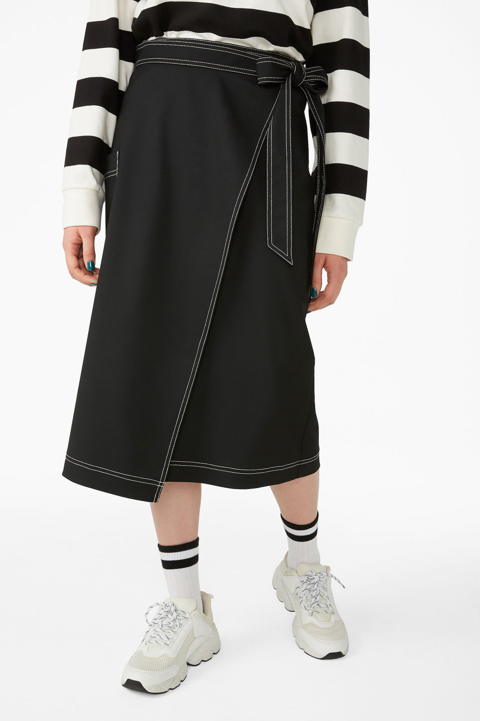 Model side image of Monki utility midi skirt in black