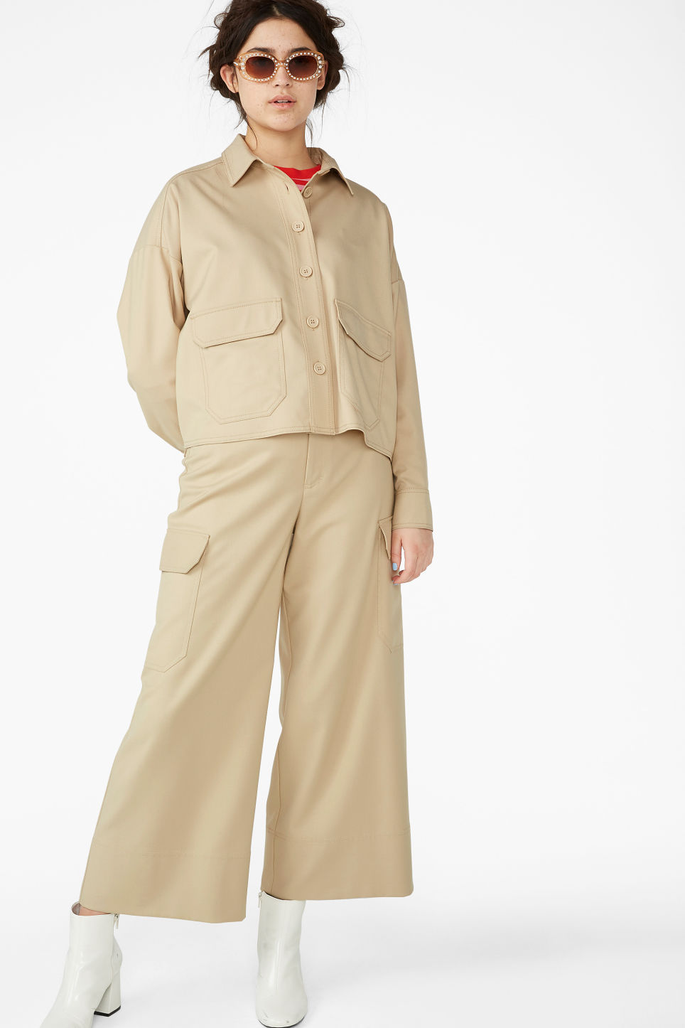 Model front image of Monki utility shirt in beige