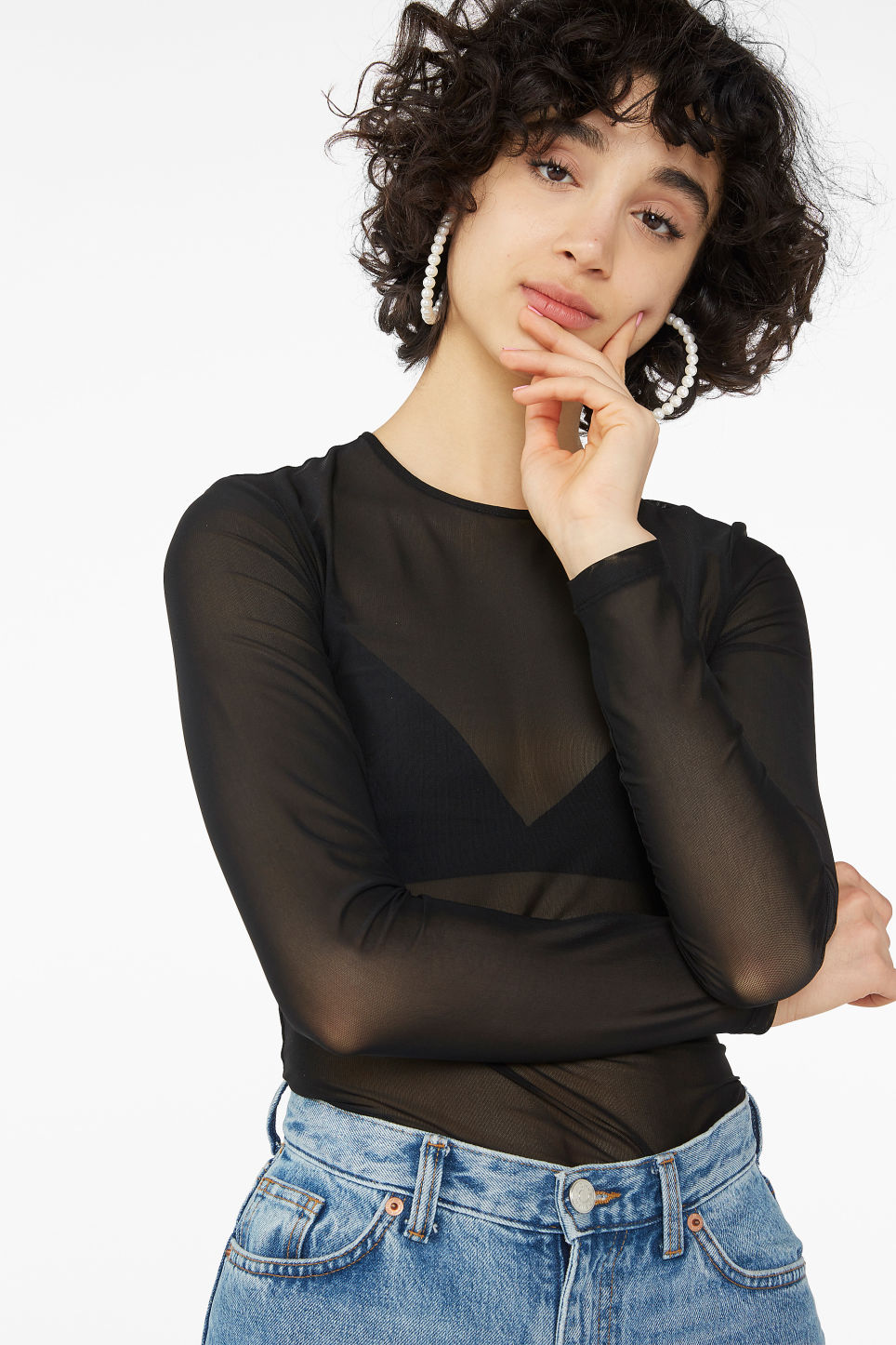 Model front image of Monki long-sleeved mesh top in black