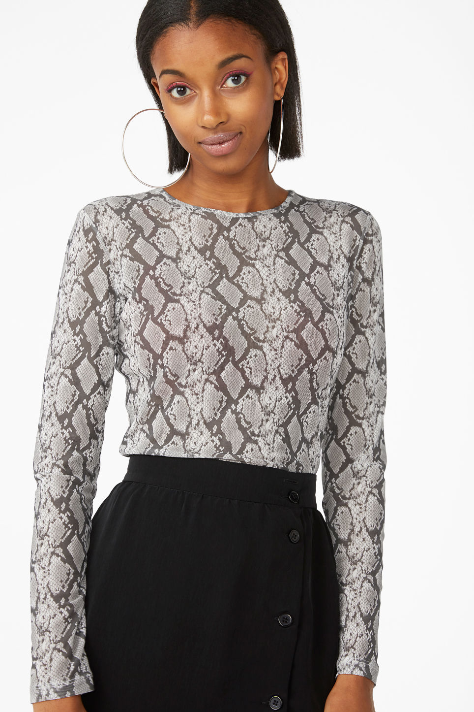 Model front image of Monki long-sleeved mesh top in grey
