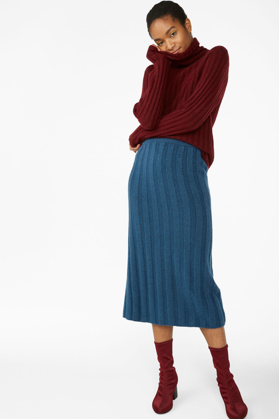 Model side image of Monki knit turtleneck sweater in red