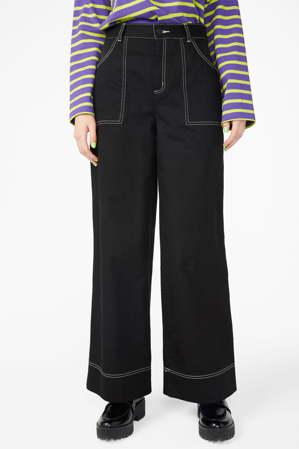 Model side image of Monki contrast stitch utility trousers in black