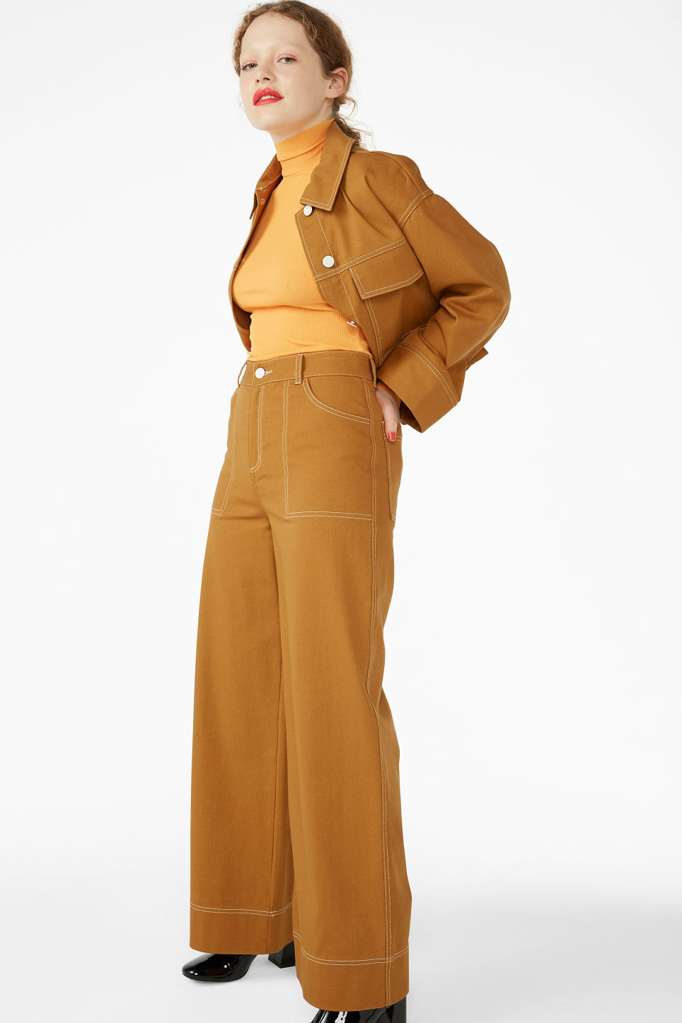 Model front image of Monki contrast stitch utility trousers in yellow