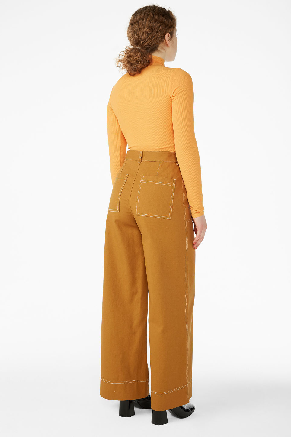 Model back image of Monki contrast stitch utility trousers in yellow