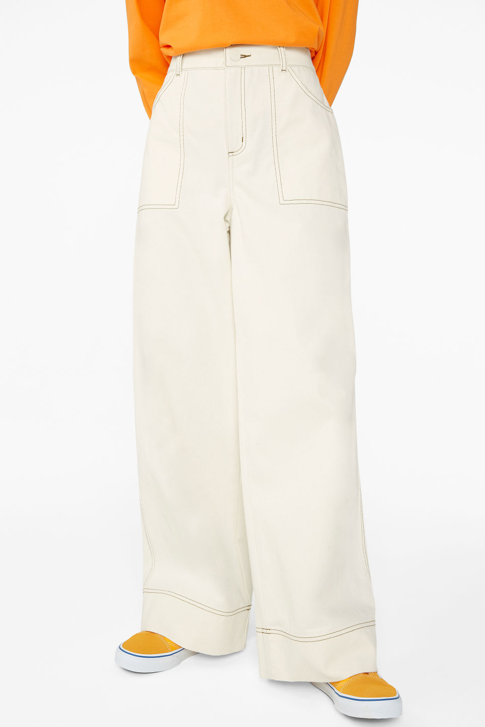Model side image of Monki contrast stitch utility trousers in beige