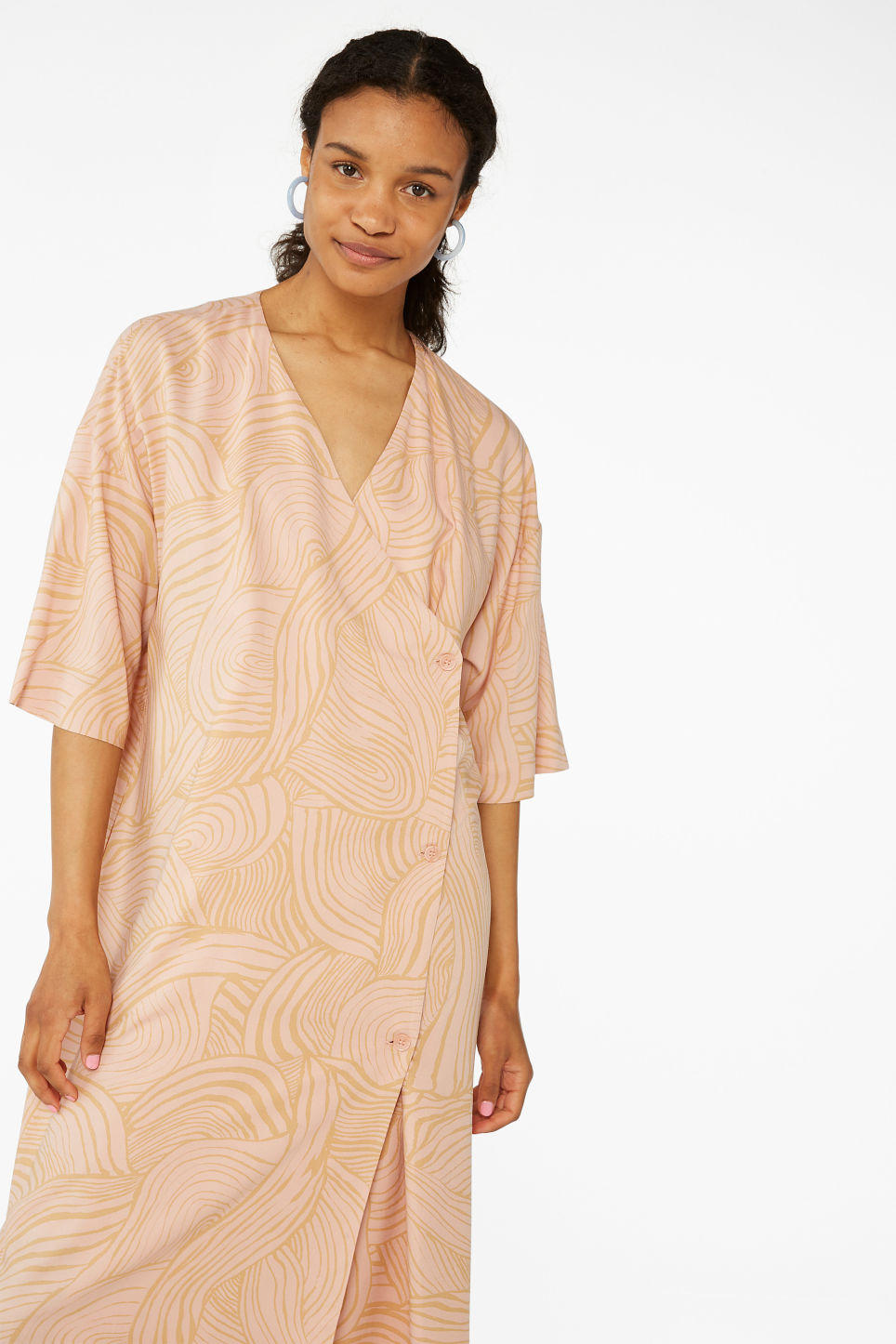 Model front image of Monki buttoned wrap dress in orange