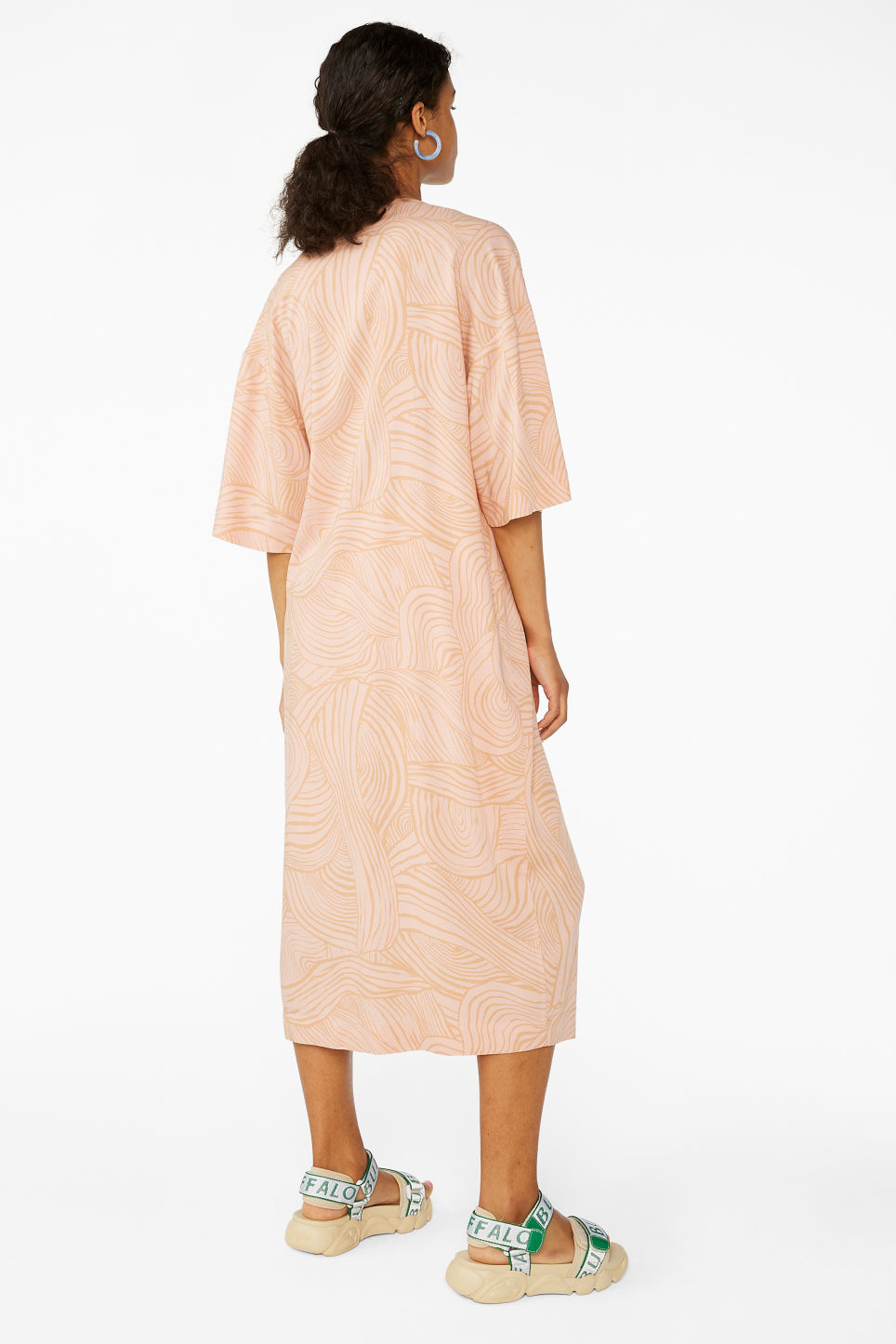 Model back image of Monki buttoned wrap dress in orange