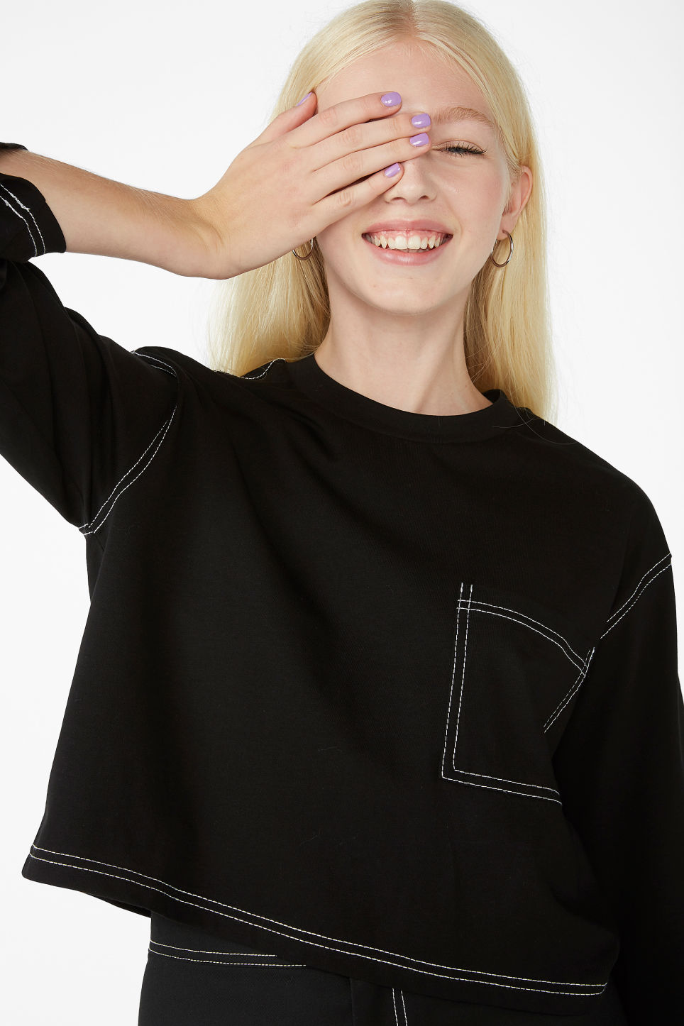 Model front image of Monki contrast stitch crop tee in black