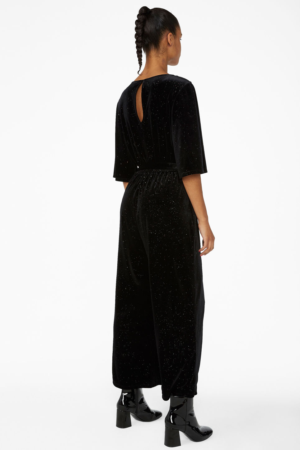 Model back image of Monki velvet jumpsuit in black