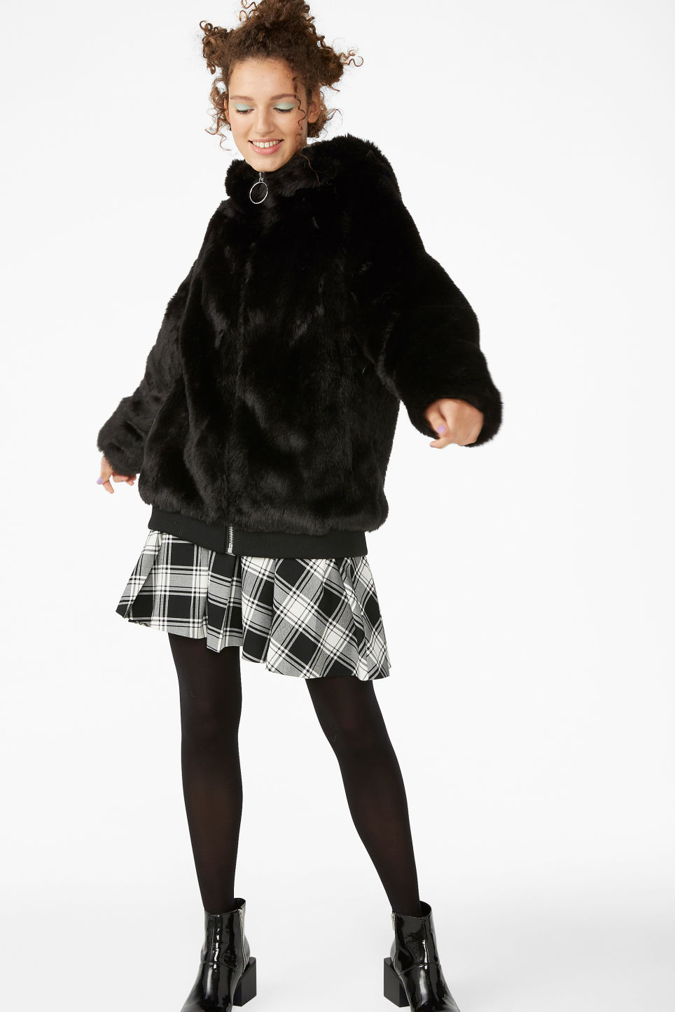 Model front image of Monki hooded faux fur jacket in black
