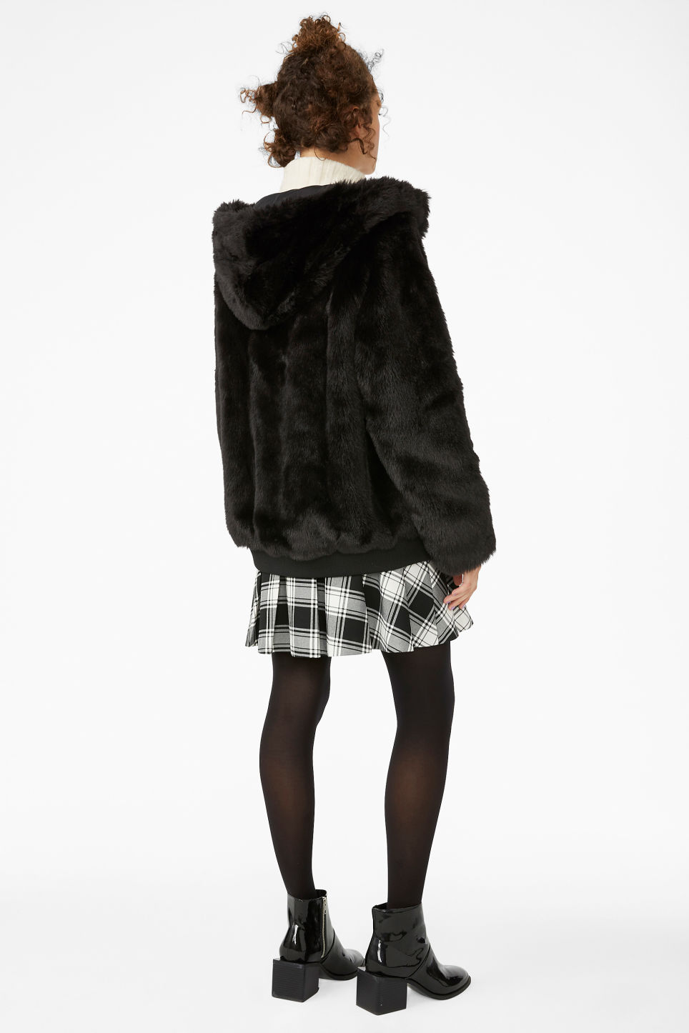 Model back image of Monki hooded faux fur jacket in black