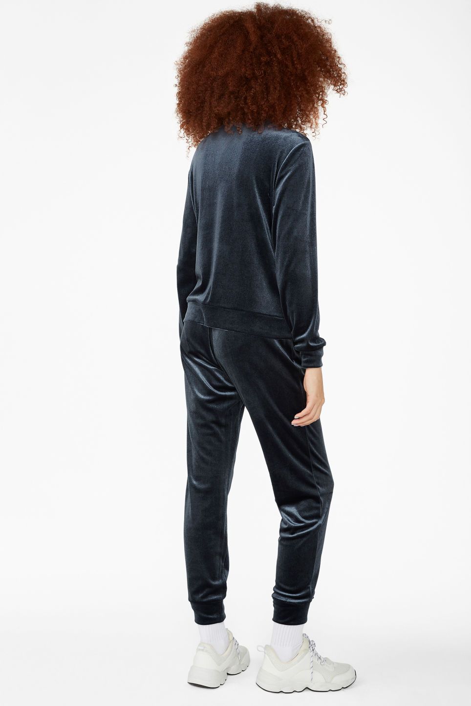 Model back image of Monki zip sweater in blue