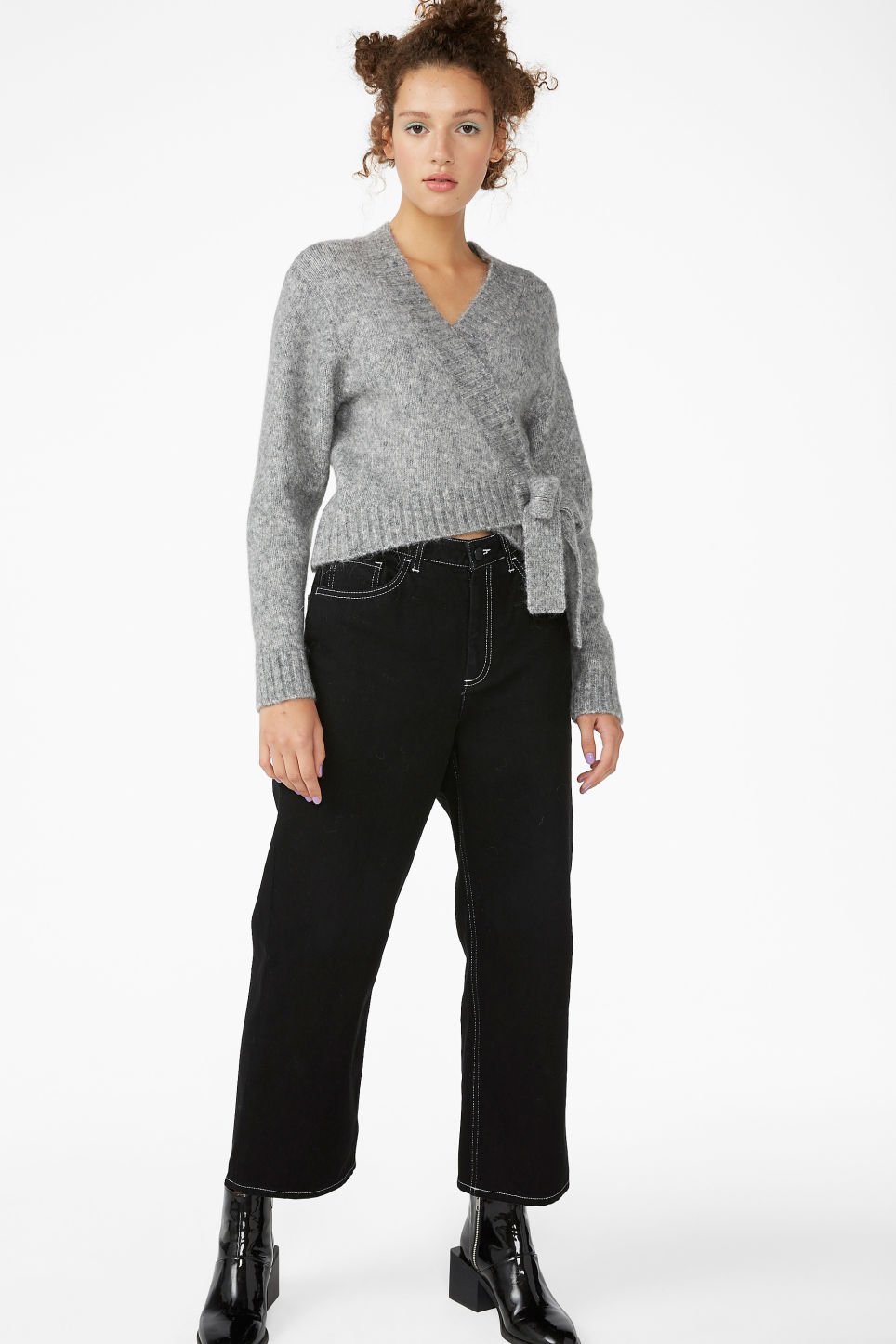 Model side image of Monki knitted wrap top in grey