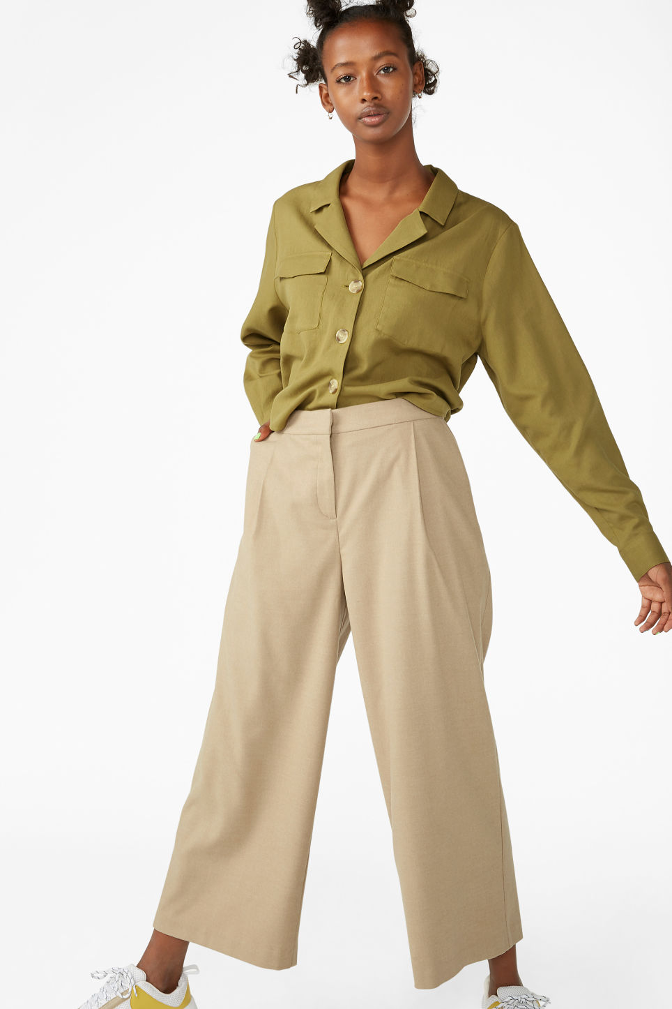 Model side image of Monki utility blouse in beige