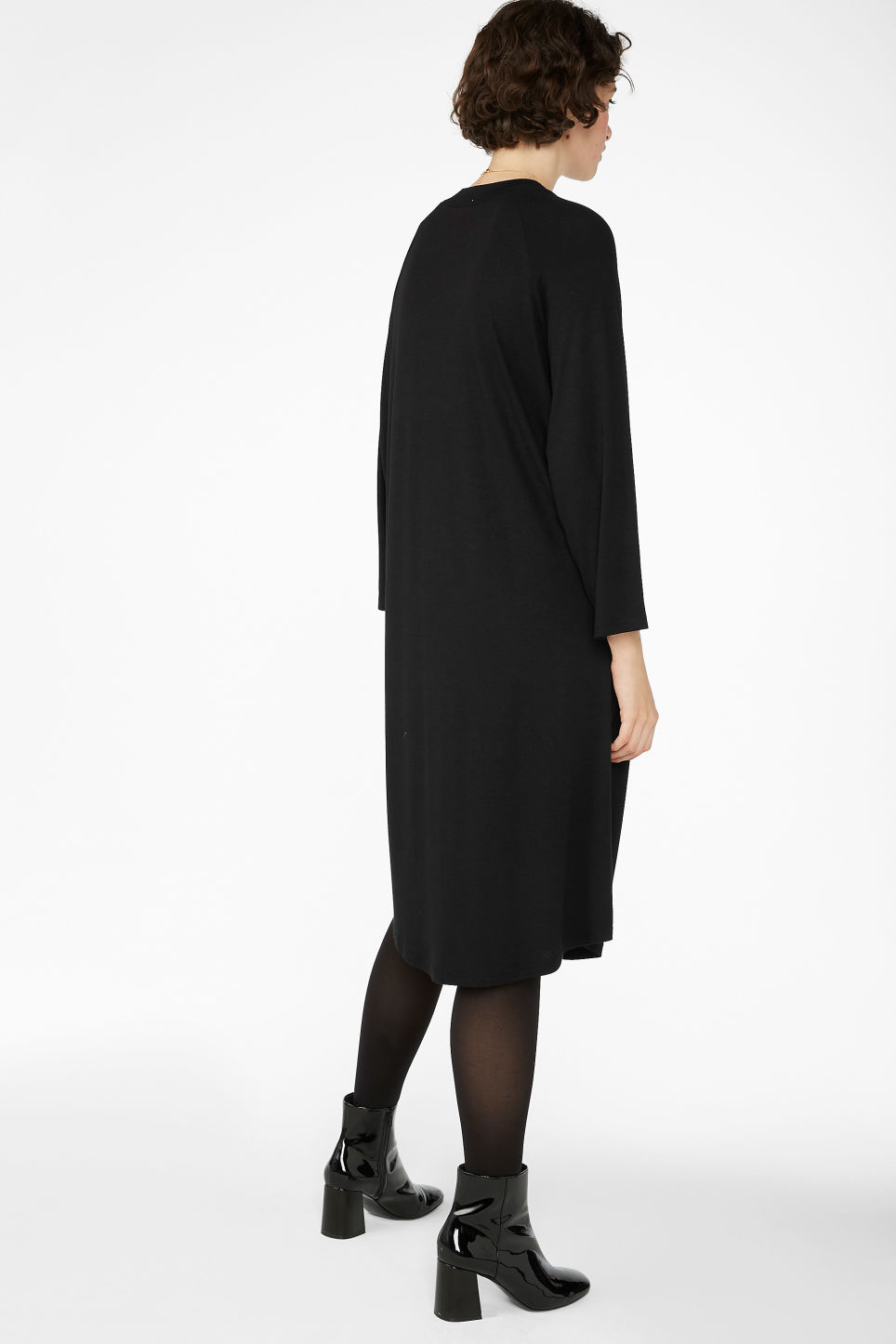 Model back image of Monki long t-shirt dress in black