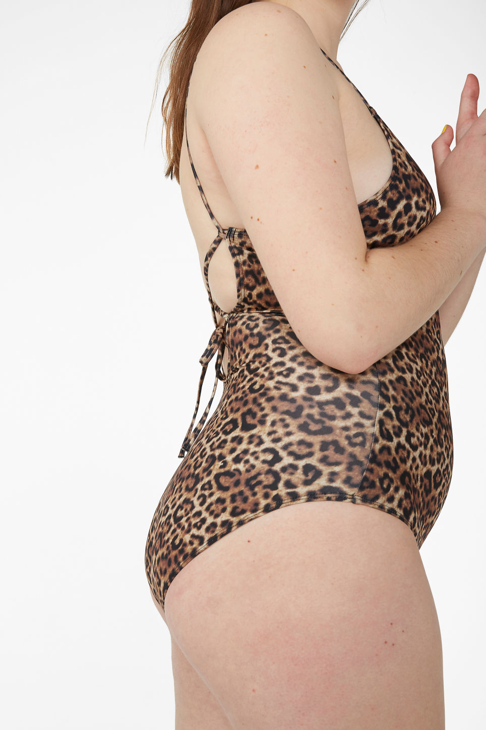 Model side image of Monki cross-back tie swimsuit  in yellow