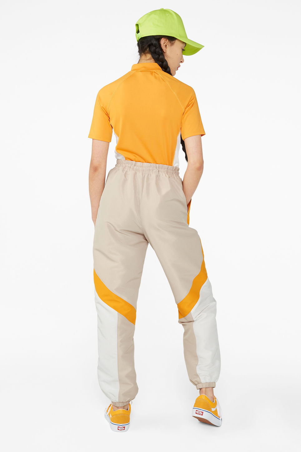 Model back image of Monki track suit pants in beige