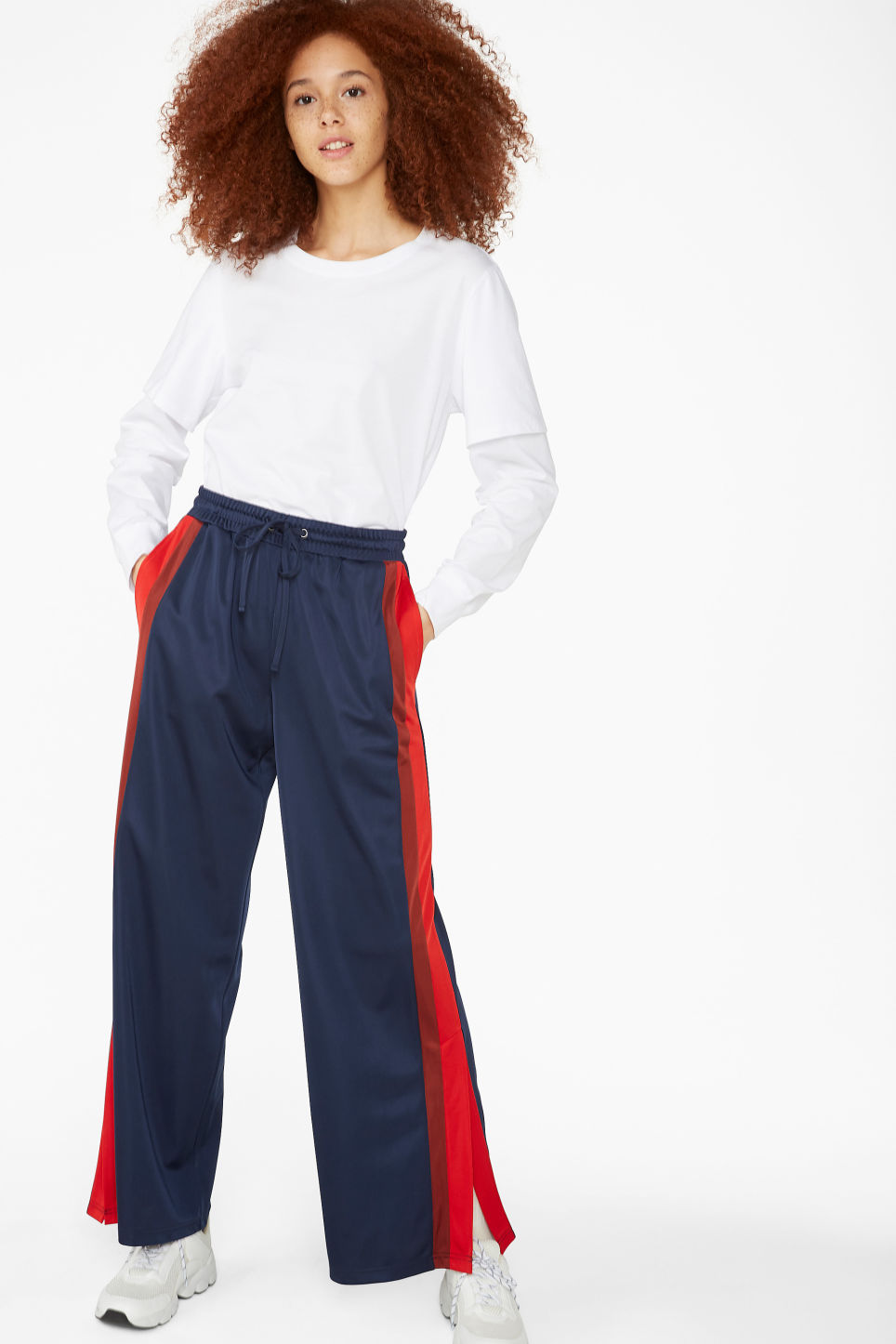 Model side image of Monki double-sleeved shirt in white