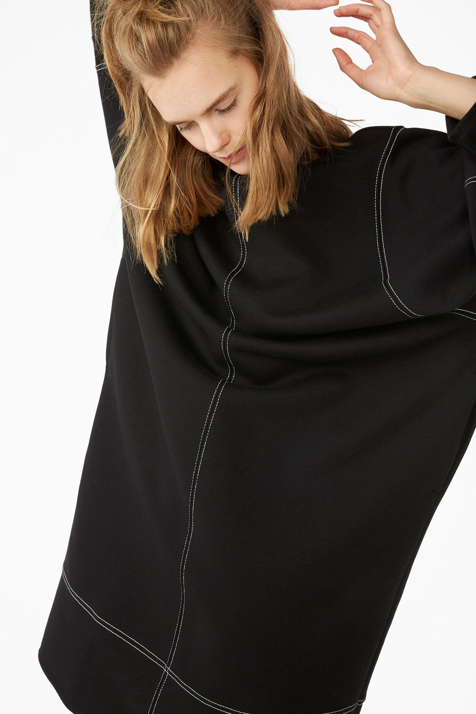 Model front image of Monki contrast stitch sweater dress in black