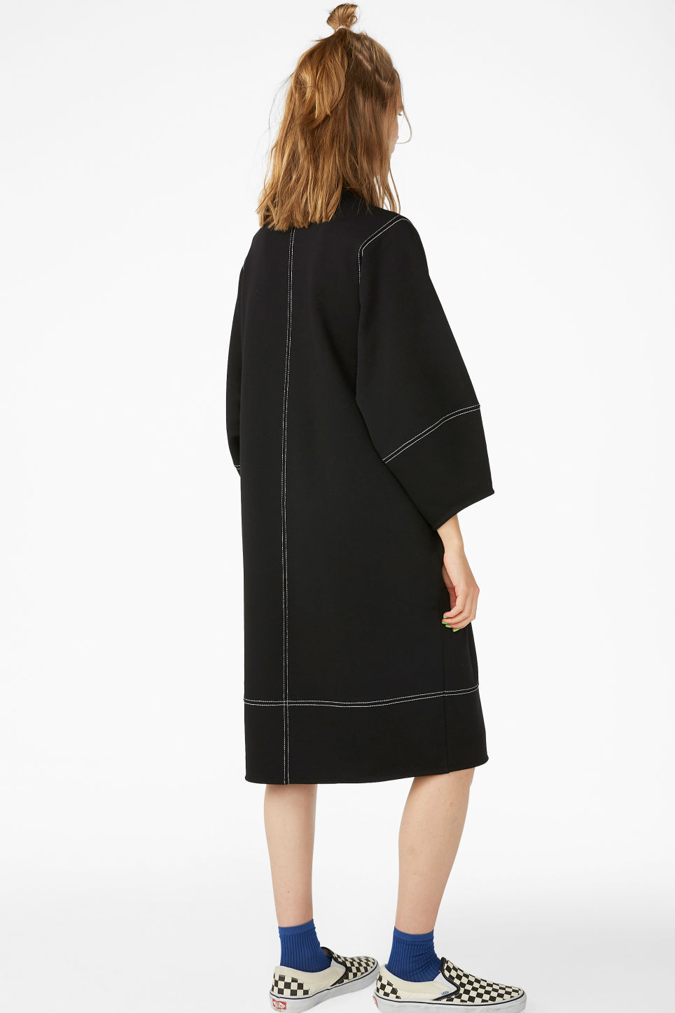 Model back image of Monki contrast stitch sweater dress in black