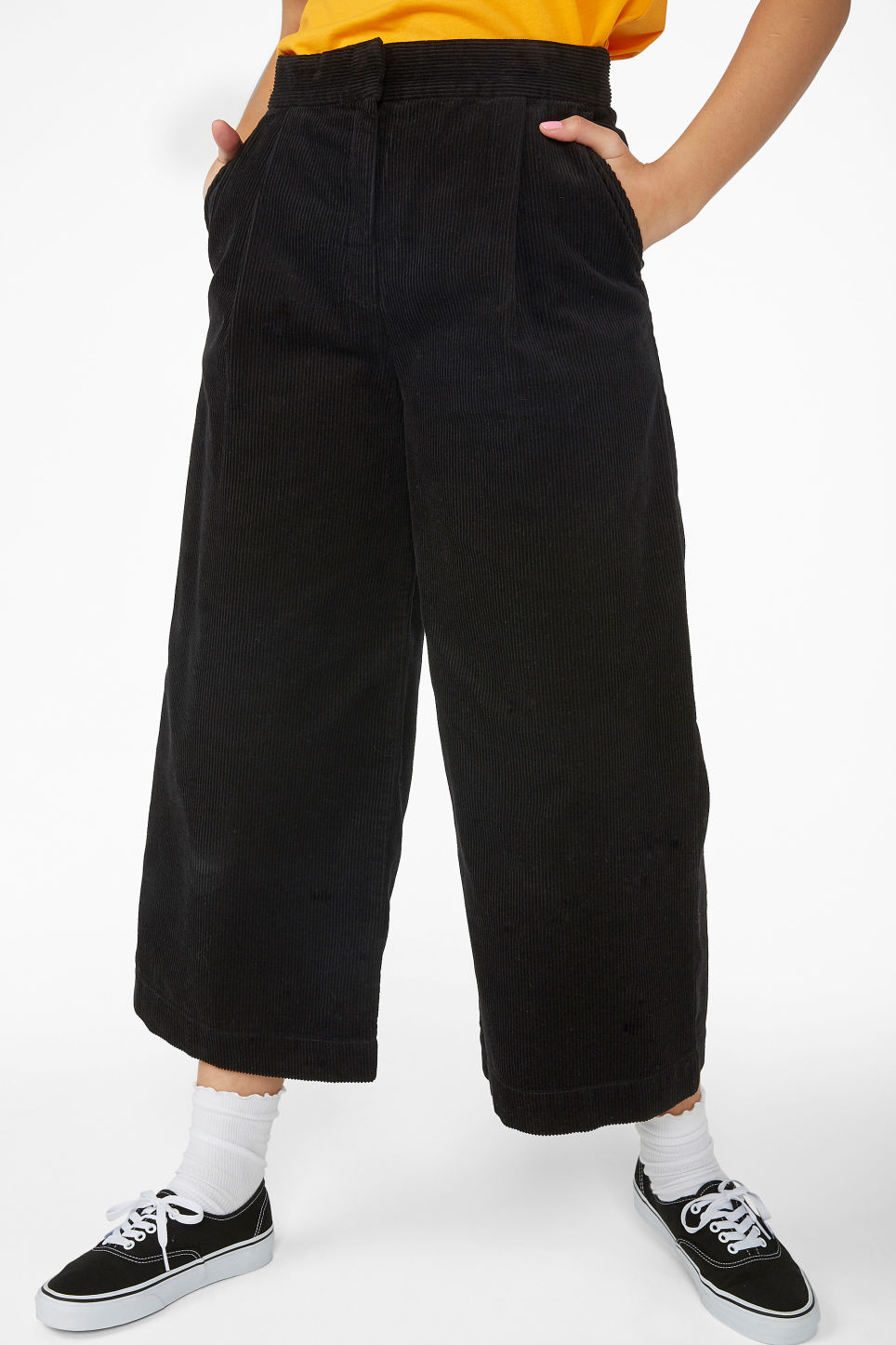 Model side image of Monki corduroy culottes in black