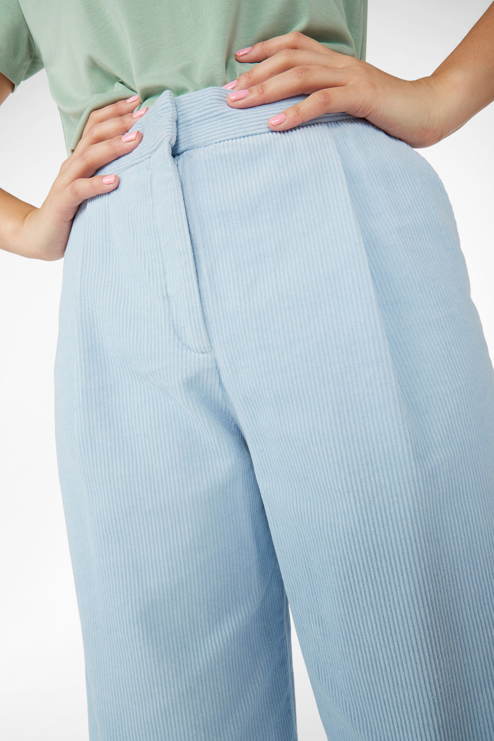 Model side image of Monki corduroy culottes in blue