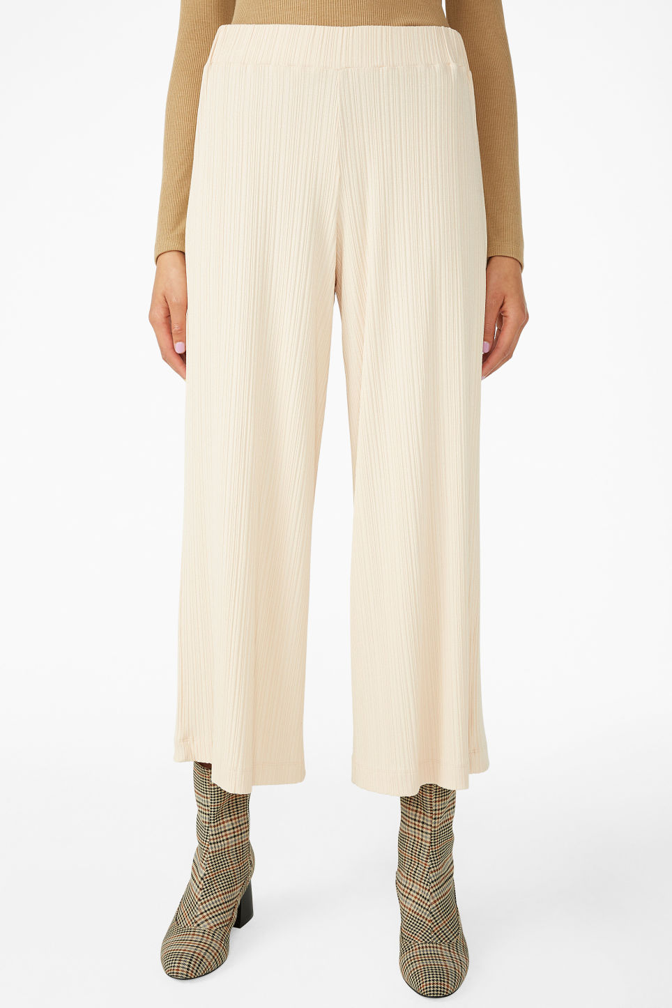 Model side image of Monki ribbed trousers in beige