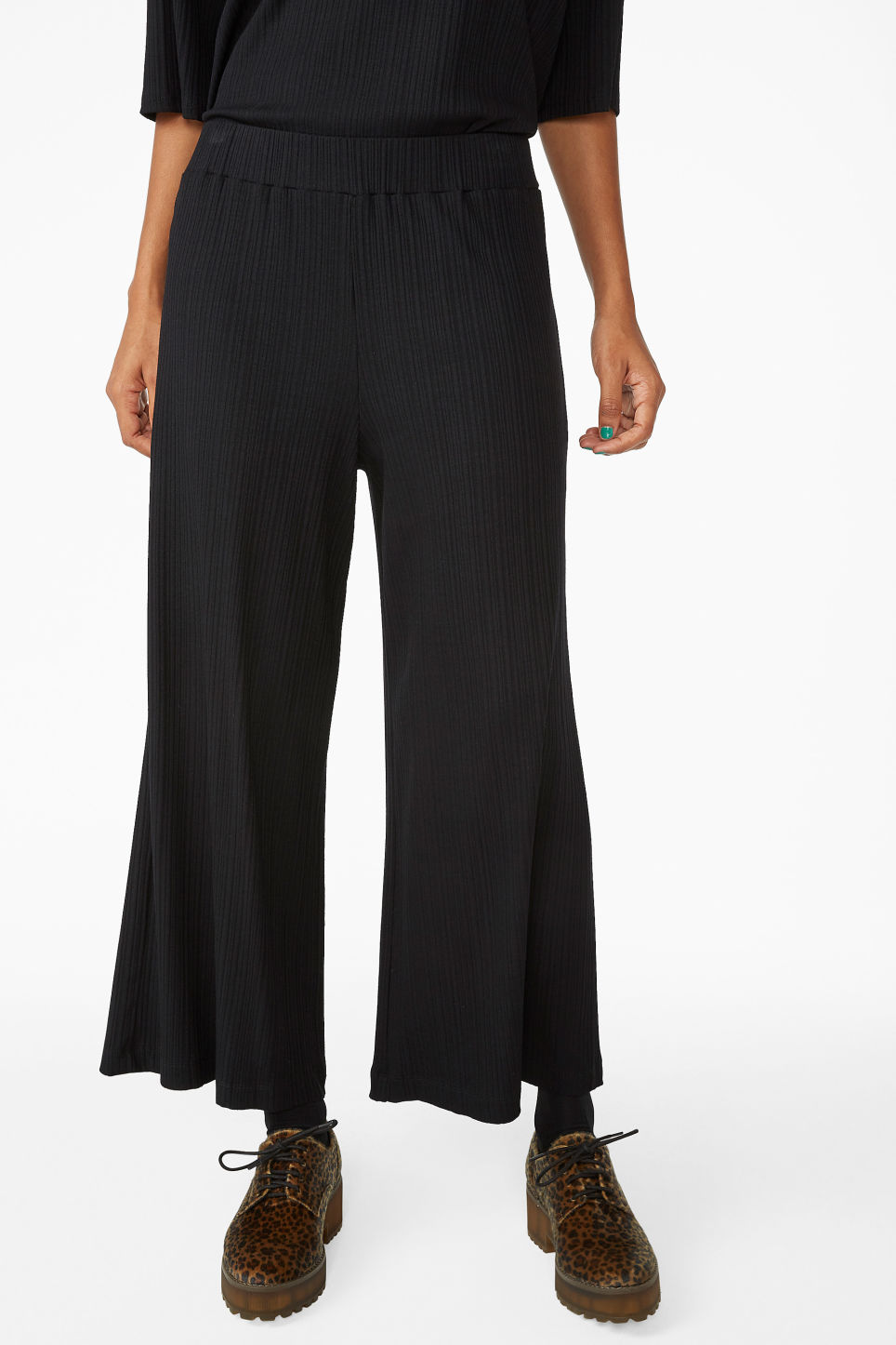 Model side image of Monki ribbed trousers in black