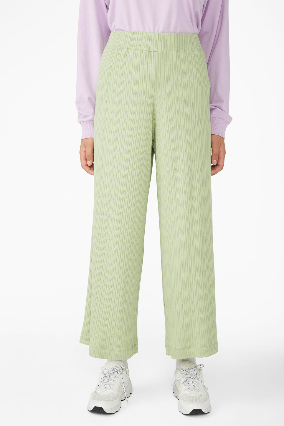 Model side image of Monki ribbed trousers in green