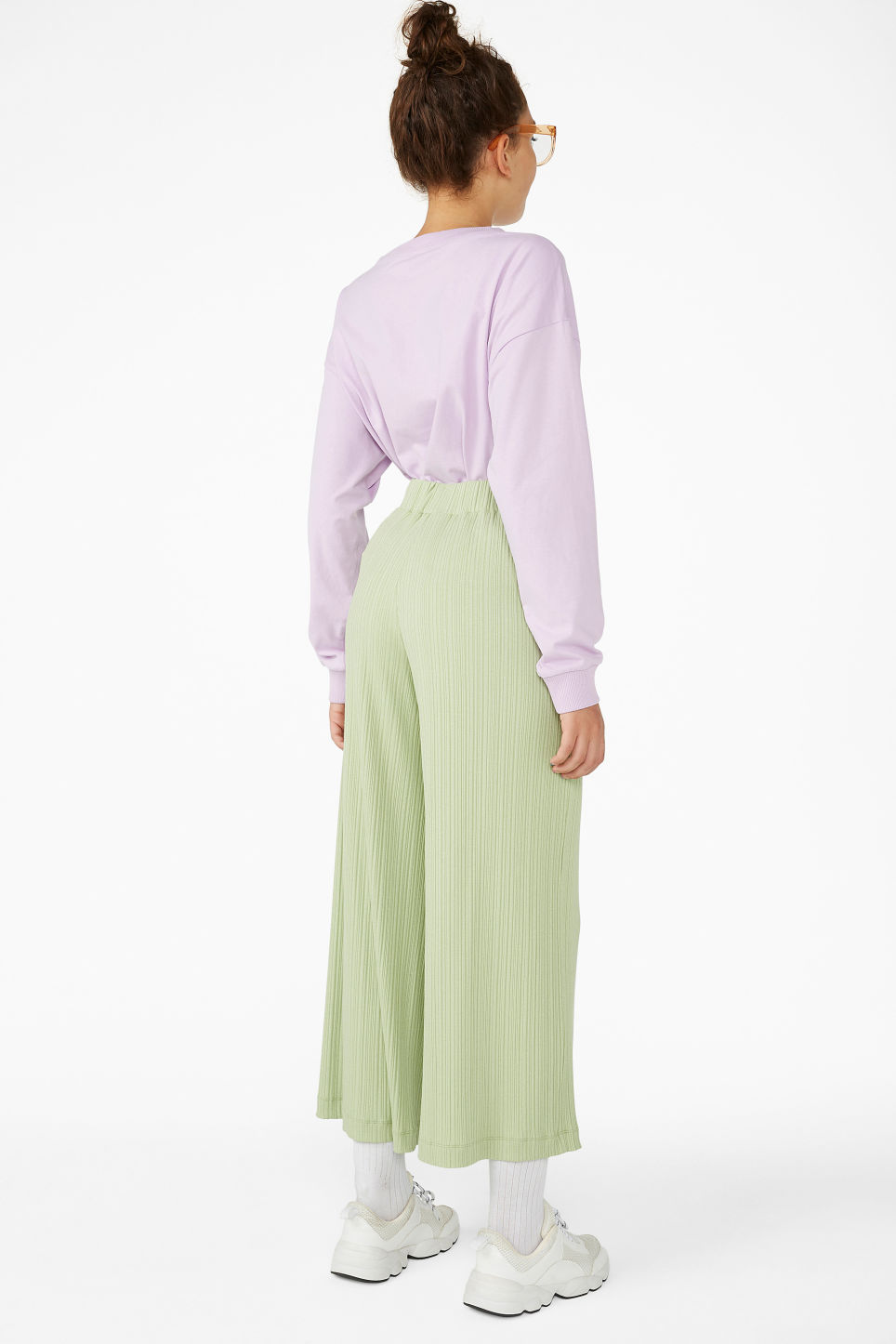 Model back image of Monki ribbed trousers in green