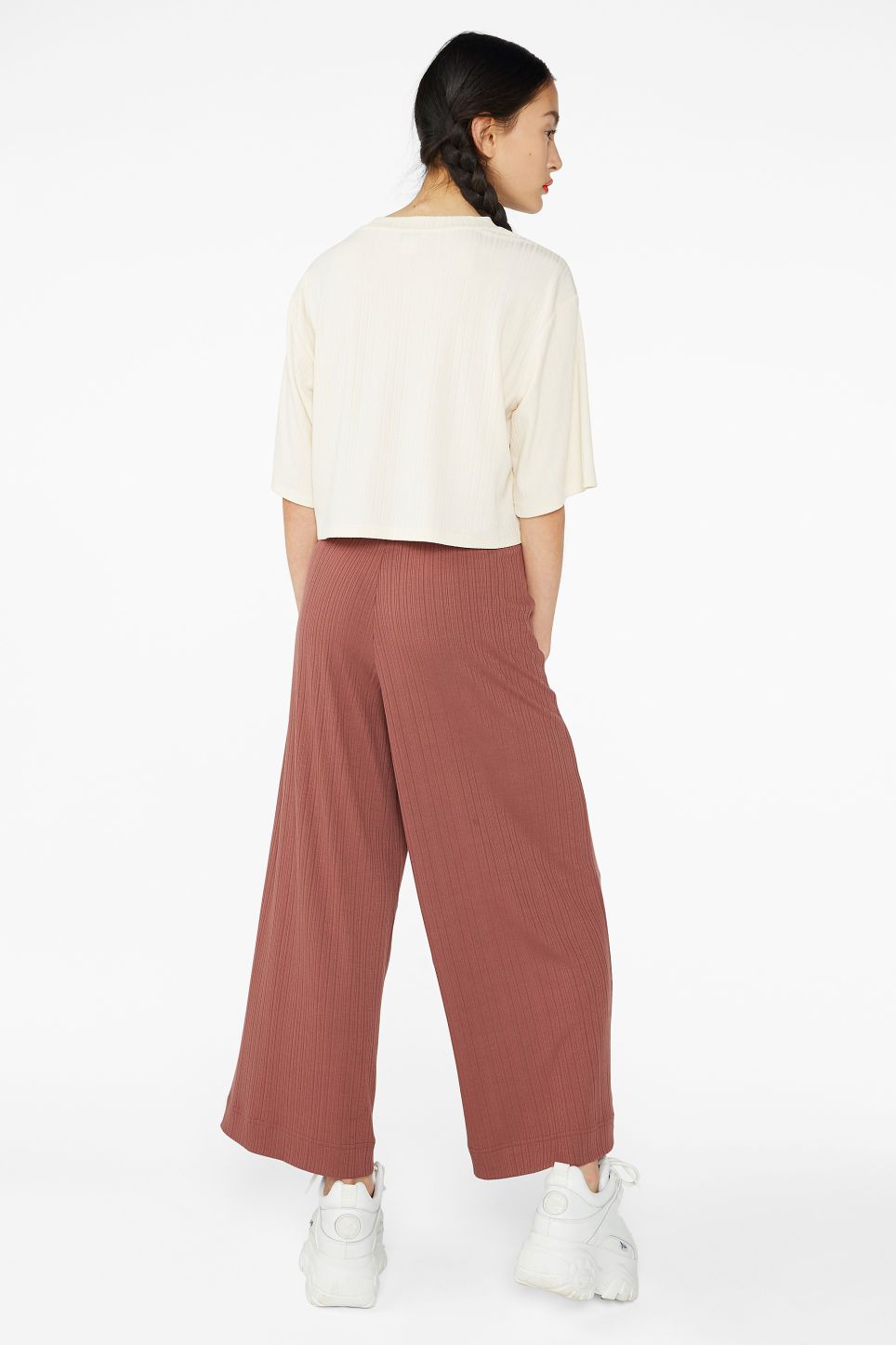 Model back image of Monki wide ribbed trousers in orange