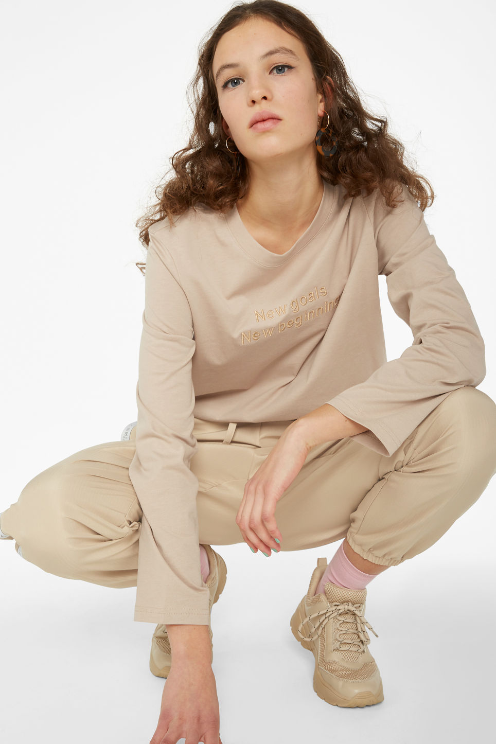 Model front image of Monki long-sleeved top in beige